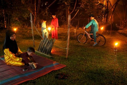 Malam Raya ... The models: my wife and our four sons.